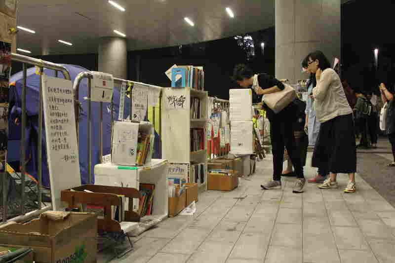 Protesters built a library in the parking lot of the Hong Kong leglislative council building. Volumes include Pride and Prejudice and The Economics of John Maynard Keynes.