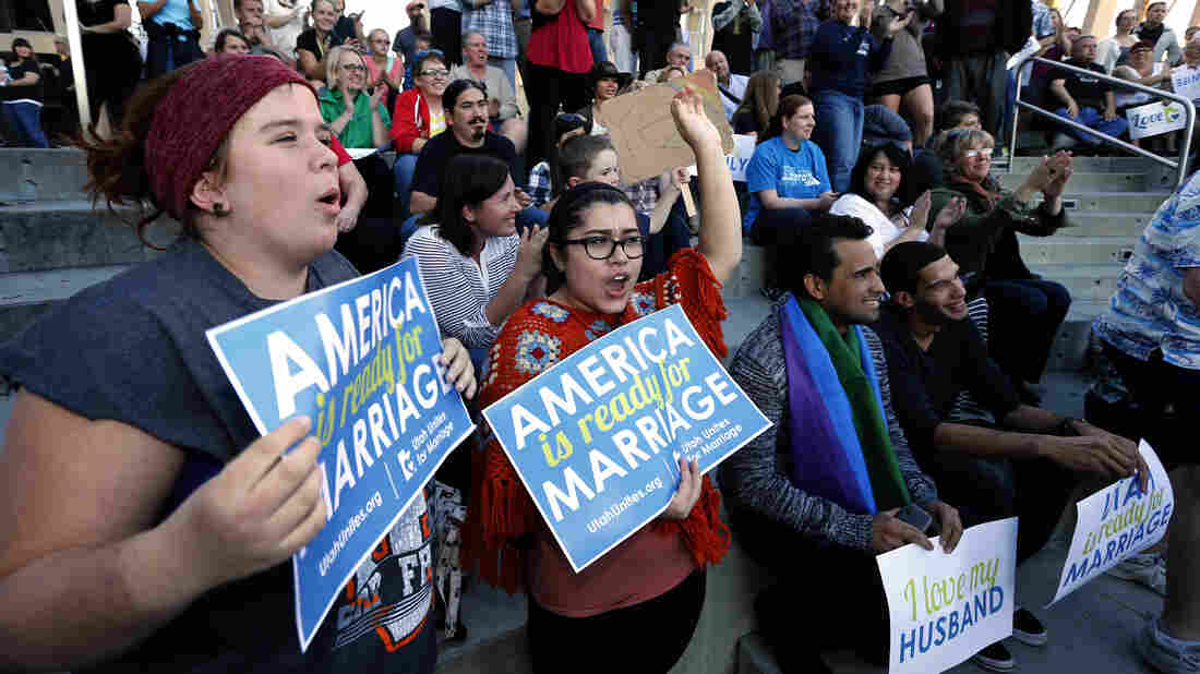 "People hold signs, including some reading ""America is ready for marriage,"" at a same-sex marriage victory celebration on Oct. 6 in Salt Lake City, Utah. America may be ready, but Republicans aren't: Rising popular support for same-sex marriage is posing a problem for the GOP."