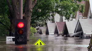 A flooded street in Cedar Rapids, Iowa. In the summer of 2008, the city ordered evacuations as Cedar River rose.