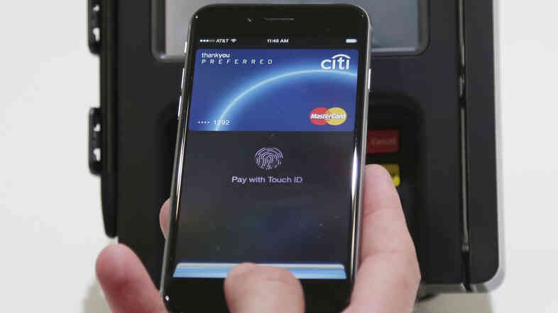 Apple Pay is demonstrated at Apple headquarters in Cupertino, Calif.