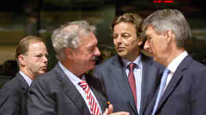 Dutch Foreign Minister Bert Koenders, center, speaks with Luxembourg's Foreign Minister Jean Asselborn, second left, and British Foreign Minister Philip Hammond, right, during a round table meeting of EU foreign min