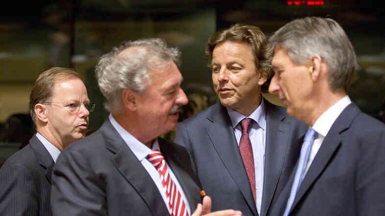 Dutch Foreign Minister Bert Koenders (center) speaks with Luxembourg Foreign Minister Jean Asselborn (second from left) and British Foreign Minister Philip Hammond (right) during a round table meeting of EU foreign ministers in Luxembourg on Monday. The ministers hope to raise 1 billion euros to fight Ebola.