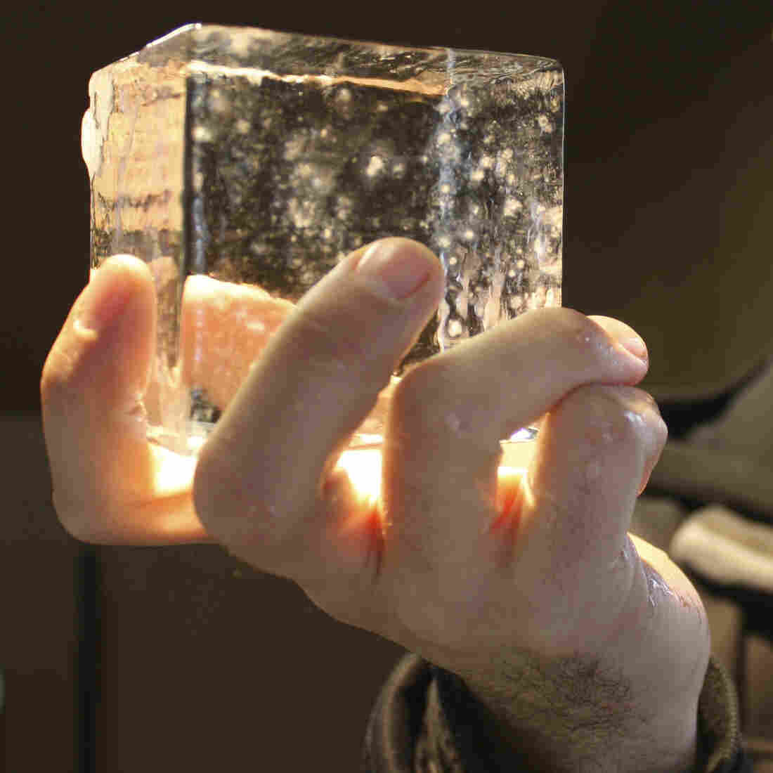 Joe Ambrose of Favourite Ice holds one of his crystal-clear artisanal cubes.