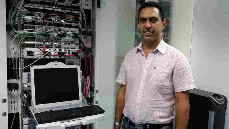 Ramzi El-Fekih, CEO of Creova, stands in his server room in Tunis. He has built a mobile payments company, but because of banking restrictions, Tunisians can use his product only for domestic purchases.