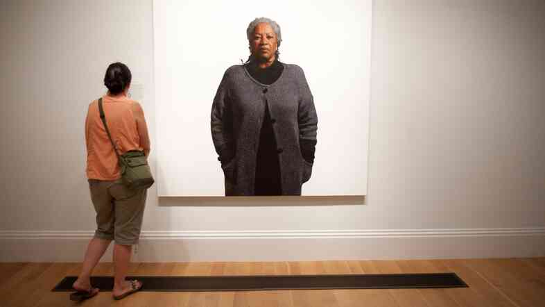 A woman looks at an oil portrait of Toni Morrison at the National Portrait Gallery. A self-portrait of sorts, Morrison's life of fiction drawn in words will be permanently kept at Princeton.