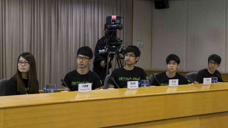 Hong Kong Federation of Students council members attend a meeting with senior Hong Kong government officials in Hong Kong on Tuesday.