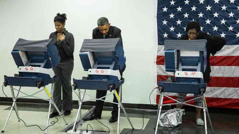 President Barack Obama casts a ballot in early voting for the 2014 midterm elections at the Dr. Martin Luther King Community Service Center in Chicago on Monday.