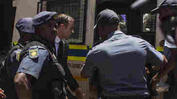 Oscar Pistorius leaves the North Gauteng High Court in Pretoria, South Africa, after sentencing on Tuesday.