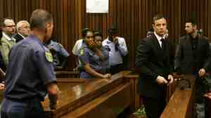 South African track star Oscar Pistorius is sentenced to five years in prison Tuesday for the fatal shooting of his girlfriend.
