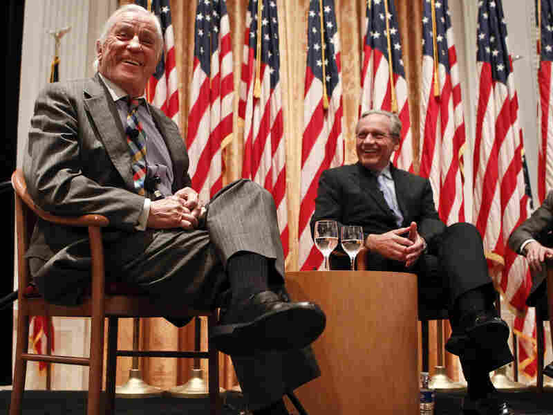 """Ben Bradlee, former executive editor of The Washington Post (left) and journalist Bob Woodward talk in 2011 during the program """"Remembering Watergate: A Conversation"""" at the Richard Nixon Presidential Library and Museum in Yorba Linda, Calif."""