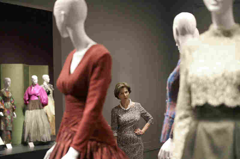Former first lady Laura Bush with Oscar de la Renta outfits on display in Dallas in July for a retrospective on the designer's career at the George W. Bush Library and Museum.