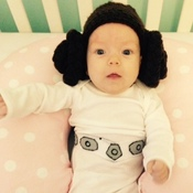 """Evelyn FitzGerald, 2 months old, is in a Princess Leia — of Star Wars renown — costume made from recycled clothes by her mother Shenandoah Brettell of El Segundo, Calif. """"I made the wig out of yarn and the belt out of felt,"""" says Shenandoah, who listens to NPR member station KPCC."""