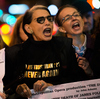 Protesters rail outside the Metropolitan Opera at Lincoln Center on opening night of the opera