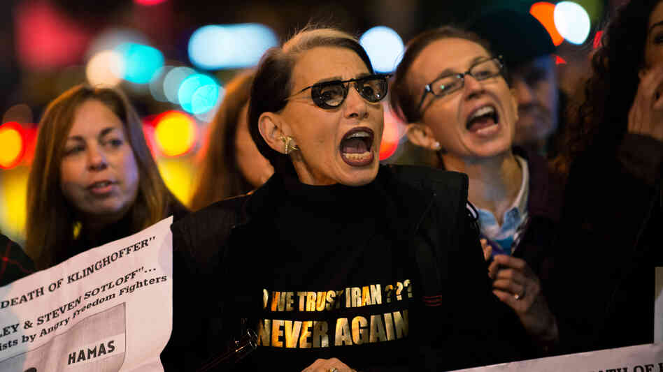 """Protesters rail outside the Metropolitan Opera at Lincoln Center on opening night of the opera """"The Death of Klinghoffer"""" on Monday in New York."""