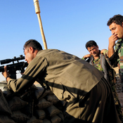 Peshmerga look out from a front-line outpost — a few sandbags, soldiers, and grenades perched on the brow of a hill — to the eastern Iraqi town of Jalula. The Kurdish fighters are grappling with how to combat changing ISIS tactics.