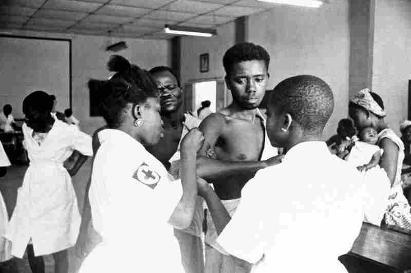 Patients in a clinic line up to get a smallpox shot on Feb. 24, 1962, in Leopoldville, Congo. Health workers used vaccination campaigns to finally eradicate smallpox by 1980.