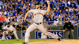 Madison Bumgarner of the San Francisco Giants pitches in the first inning against the Kansas City Royals during Game 1 of the 2014 World Series on Tuesday in Kansas City, Mo.
