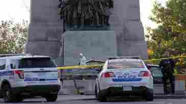 Forensic police officers work Wednesday near the National War Memorial in Ottawa, Canada, where a gunman opened fire and killed a soldier before entering Parliament Hill and firing several shots in the building. Police shot and killed the gunman and said an investigation was under way, but there was no immediate word on the gunman's motivation.