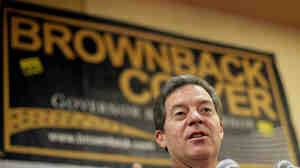 Kansas Gov. Sam Brownback is in a tight election race