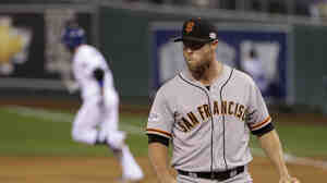 San Francisco Giants pitcher Hunter Strickland watches Wednesday as Kansas City Royals Omar Infante runs around the bases after hitting a two-run home run during the sixth inning of Game 2 of baseball's World Series Wednesday