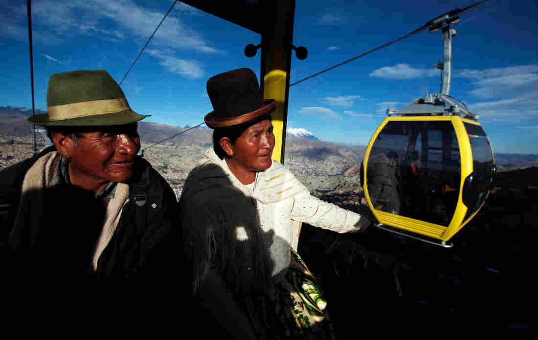 Passengers ride a cable car that links downtown La Paz with El Alto, Bolivia, in September. The trip costs about 40 cents and takes 10 minutes — compared with 35 cents and a half-hour by minibus.