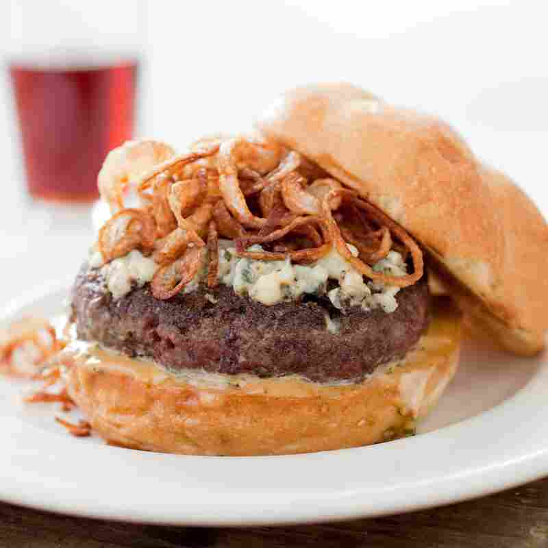 To make the best (and safest) burger, America's Test Kitchen recommends grinding the meat at home and packing it loosely.