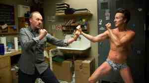 In Birdman, Ed Norton (right) plays a talented but pretentious actor in a Broadway play being directed by an actor he disrespects (Michael Keaton, left) for having starred in a series of Birdman superhero films.