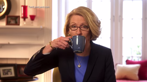 "In this campaign ad, GOP candidate Terri Lynn Land sips coffee after asking the viewer to ""think about"" accusations that she's waging a war on women."