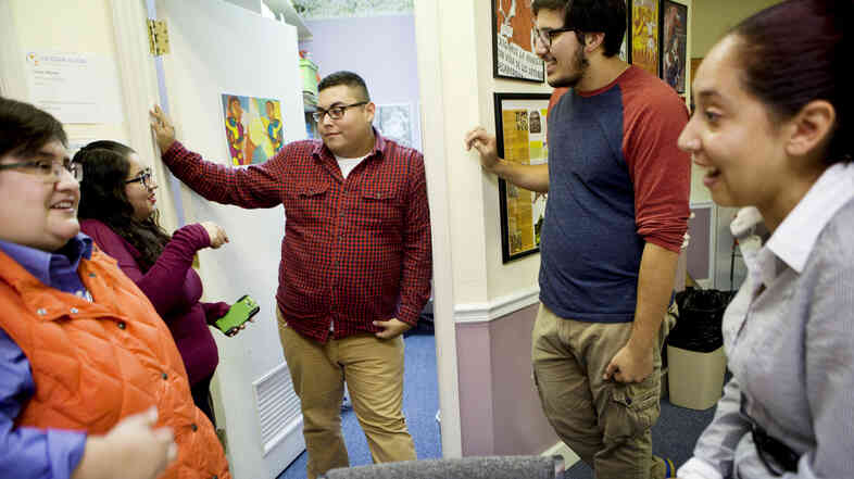 Lacey Williams (from left), Mary Espinosa, Jaime Villegas, Armando Cruz Martinez and Elisa Benitez talk inside the offices of the Latin American Coalition in Charlotte, N.C. According to a 2011 Pew Hispanic report, the median age of Latinos in North Carolina is 24.