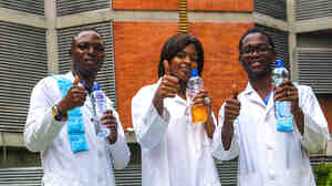 At the onset of symptoms, Dr. Adaora Ingonoh (center) and her colleagues began drinking oral rehydration solution. It doesn't taste great but they say it helped them survive Ebola. They each downed over a gallon a day for nearly a week.