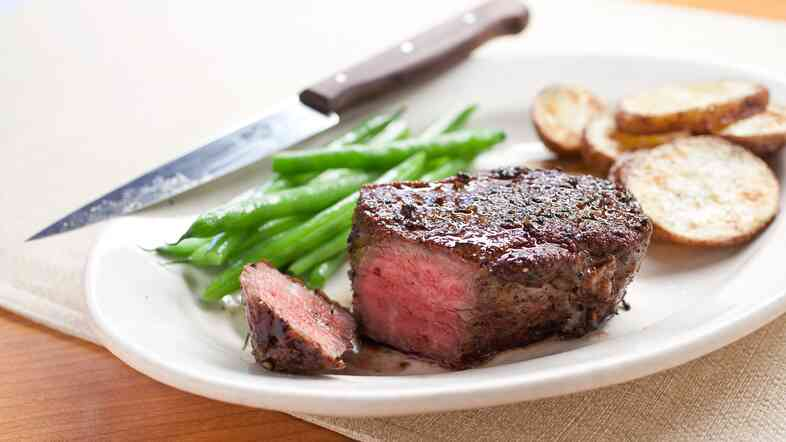 America's Test Kitchen recommends cooking meat, like this pan-seared steak, at a moderate temperature to seal in the juices.