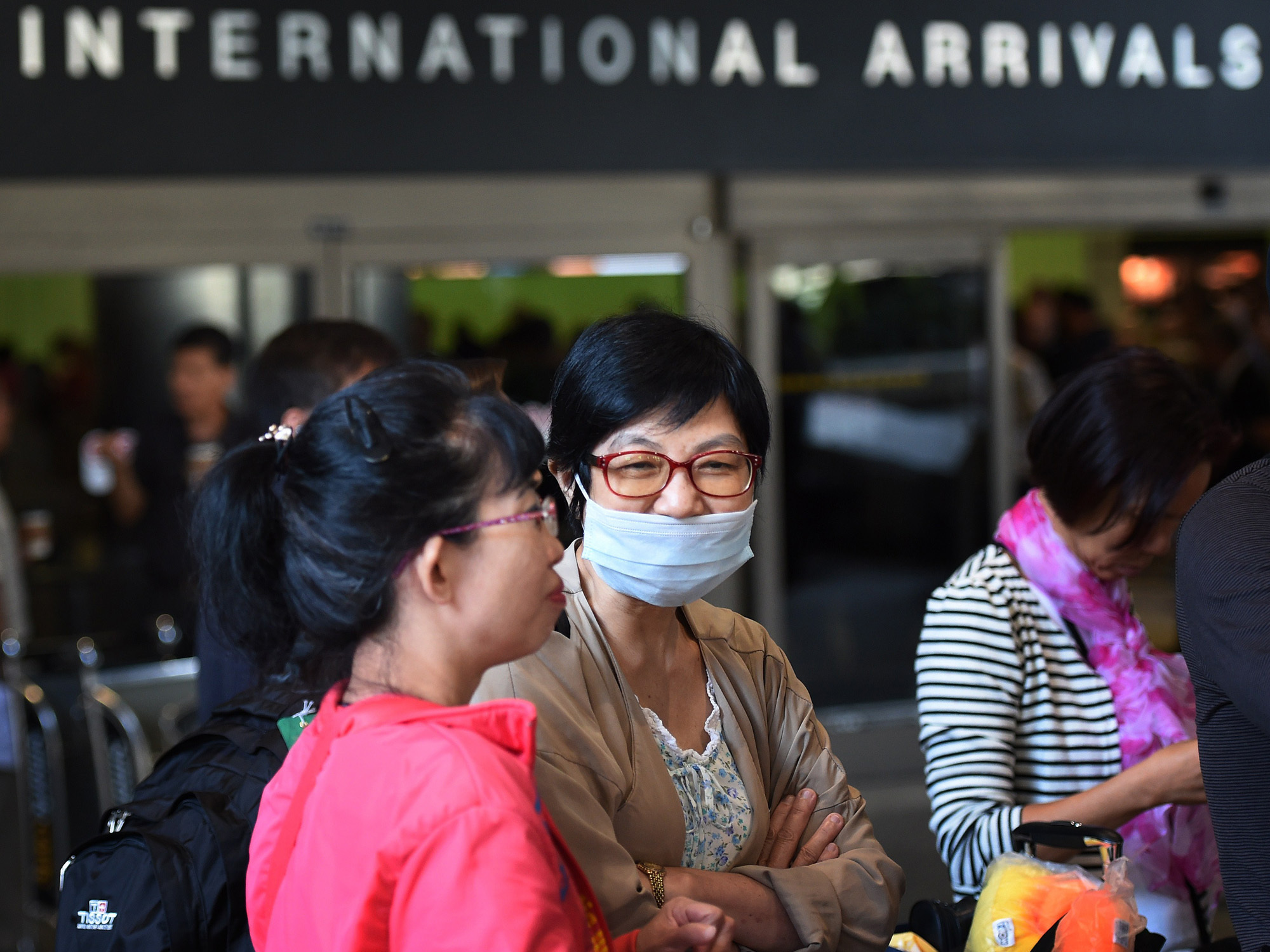 A passenger wearing a face mask arrives at Los Angeles International Airport Friday. Federal officials now require people traveling from West Africa to enter the U.S. at one of five airports equipped to screen them for signs of Ebola.A poll of Americans found almost all are aware of Ebola and that a majority are concerned about its spread to the U.S.A passenger wearing a face mask arrives at Los Angeles International Airport Friday. Federal officials now require people traveling from West Africa to enter the U.S. at one of five airports equipped to screen them for signs of Ebola.A poll of Americans found almost all are aware of Ebola and that a majority are concerned about its spread to the U.S.
