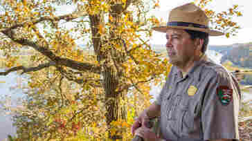 Jim Nepstad, superintendent of Effigy Mounds National Monument in northeast Iowa, stands at the top of a bluff looking over the Mississippi River.