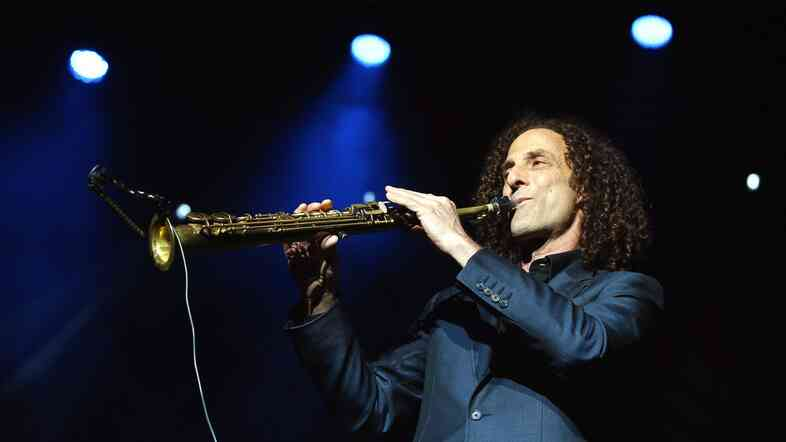 "After deleting tweets from a Hong Kong protest site, Kenny G said he was ""not trying to defy government orders."""