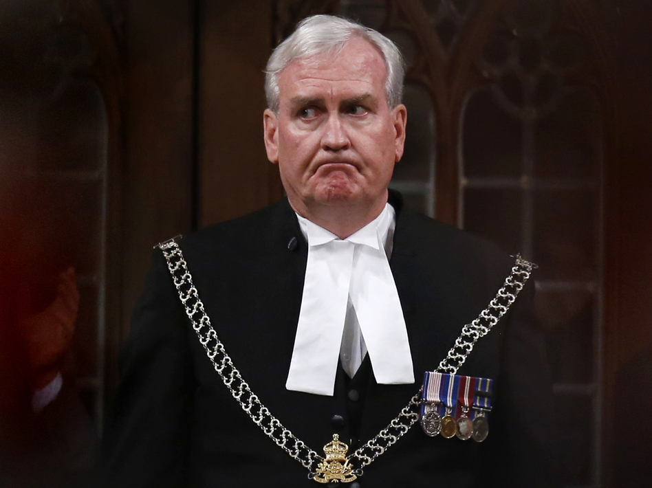 Sergeant-at-Arms Kevin Vickers is applauded in the House of Commons in Ottawa on Thursday. Vickers was credited with shooting the suspect during an attack on the Parliament complex on Wednesday. (Chris Wattie/Reuters/Landov)