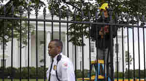 A Secret Service police officer walks outside the White House in Washington on Thursday.