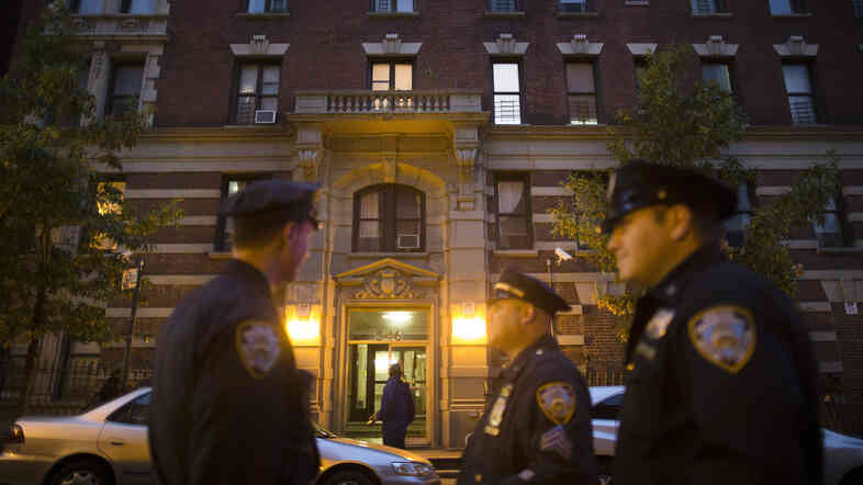 Police officers stand outside the home of Craig Spencer, a Doctors Without Borders physician who recently returned to the city after treating Ebola patients in West Africa, on Thursday in New York. Spencer tested positive for the virus, according to preliminary test results, city officials said.