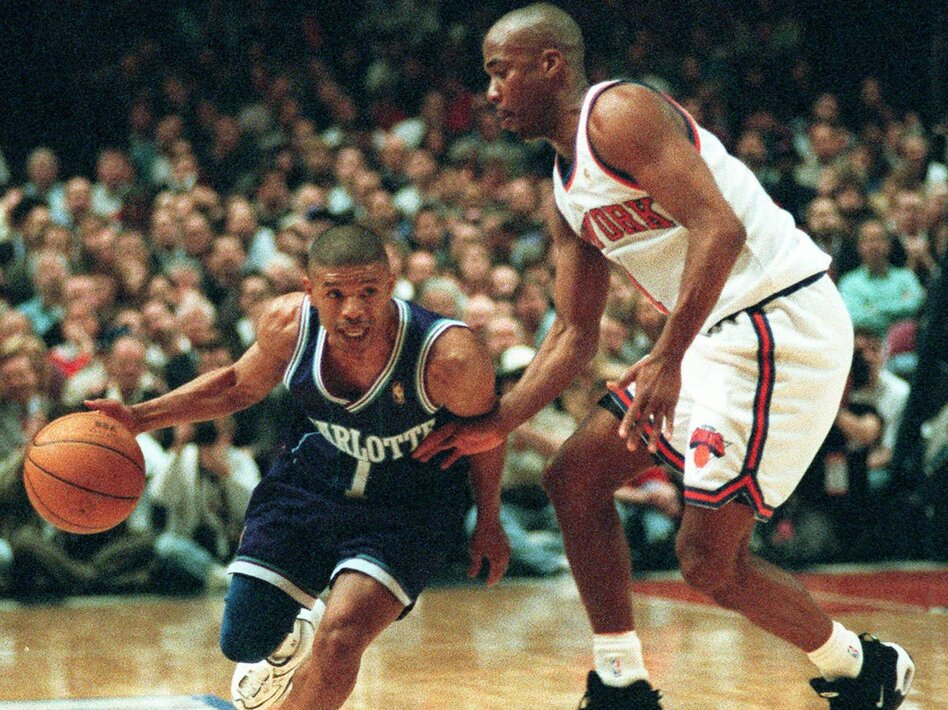 Charlotte Hornets guard Muggsy Bogues (works his way around New York Knicks guard Chris Childs in the first half of the NBA Eastern Conference playoffs on April 24, 1997. (Bill Kostroun/AP)