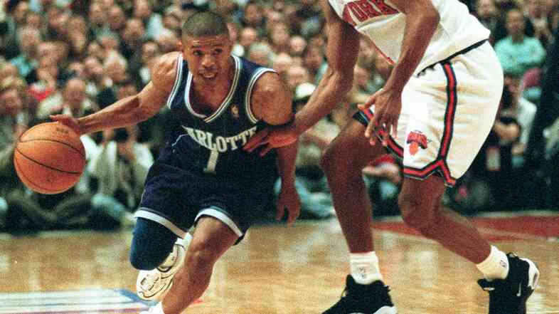 Charlotte Hornets guard Muggsy Bogues (left) works his way around New York Knicks guard Chris Childs in the first half of the NBA Eastern Conference playoffs on April 24, 1997.