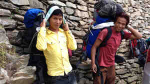 Bilbahadur Tamang, right, and Umesh Lama load up for a trek on the popular Annapurna Circuit.