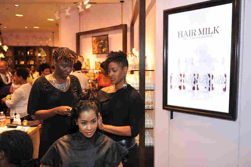 "Real Housewives of Atlanta star Lisa Wu Hartwell gets a hair treatment at a ""Curl Party"" hosted by Carol's Daughter and theYBF.com in 2010."