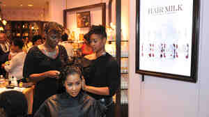 """Real Housewives of Atlanta star Lisa Wu Hartwell gets a hair treatment at a """"Curl Party"""" hosted by Carol's Daughter and theYBF.com in 2010."""