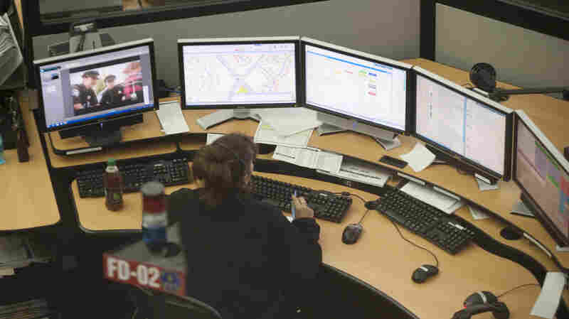 The Fairfax County 911 Center in Virginia takes calls during Hurricane Sandy in 2012. It was relatively easy to locate callers when most people used landlines. But most 911 calls now come from cellphones, which can pinpoint a callers' location only within 100 to 300 meters.