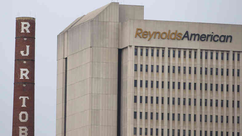 The headquarters of Reynolds American in downtown Winston-Salem, N.C.. Starting in January, workers there will no longer be allowed to smoke at their desks.