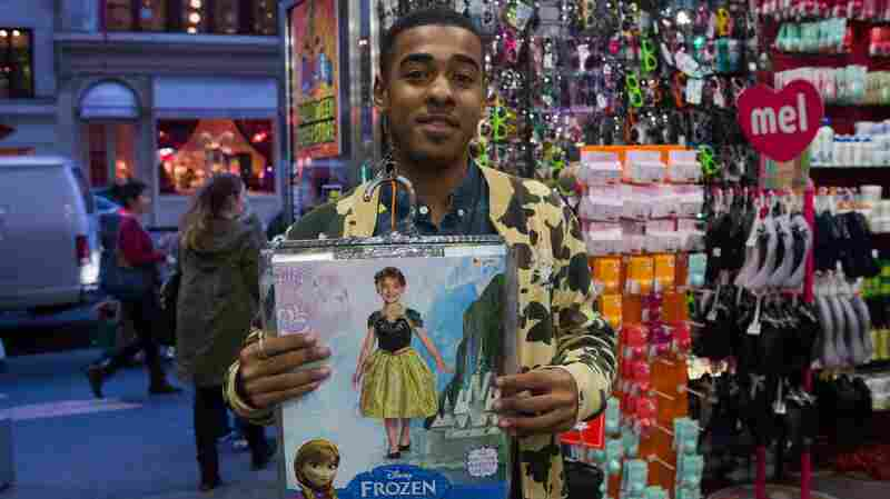 Ricky's employee, George Lanes, shows off one of this year's hottest costumes, Anna, from the movie Frozen.