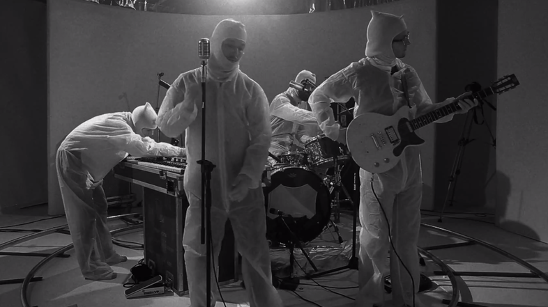 """The members of Fly Golden Eagle, in a scene from their new video for the song """"Stepping Stone."""""""