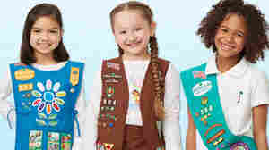 Girl Scouts model contemporary uniforms.