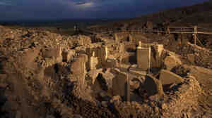 """The site at Gobekli Tepe, or """"Potbelly Hill,"""" on the Urfa plain in southeastern Turkey is believed by some to be the world's first place of worship. This would upend the conventional thought that religion developed as a byproduct of human settlements."""