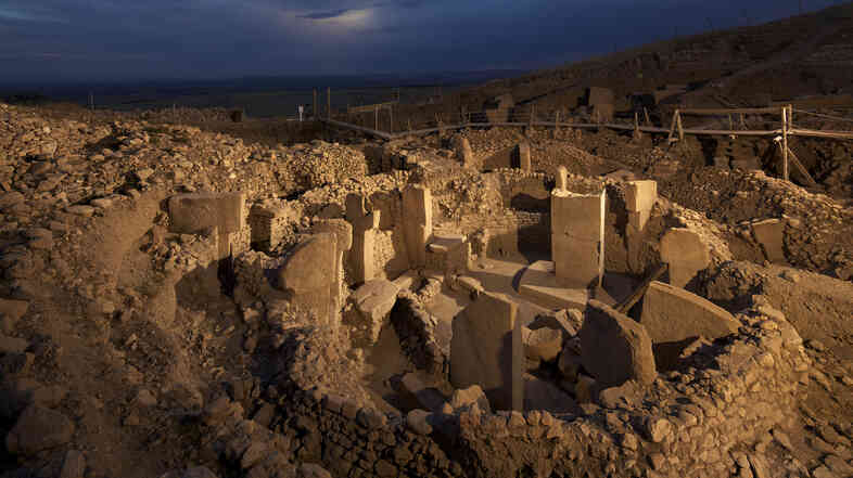 "The site at Gobekli Tepe, or ""Potbelly Hill,"" on the Urfa plain in southeastern Turkey is beli"