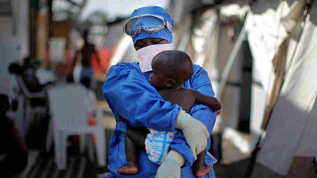 Ebola survivor Salome Karwah holds a 10-month-old baby whose parents are being treated for Ebola inside the MSF Ebola Treatment center ELWA 3 in Monrovia, Liberia.